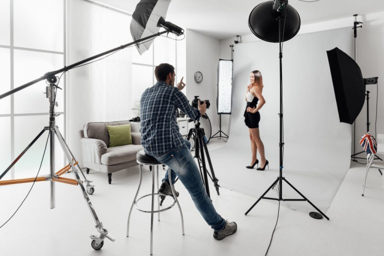 Photographer instructing his model