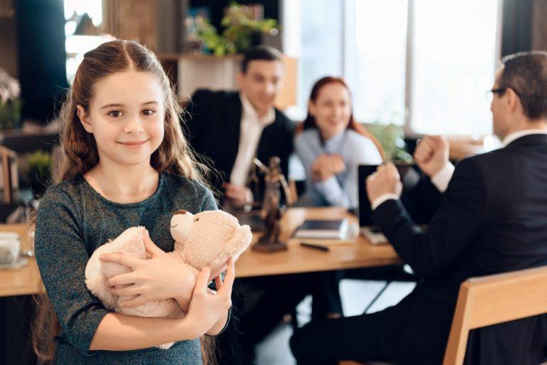 Child holding her teddy bear