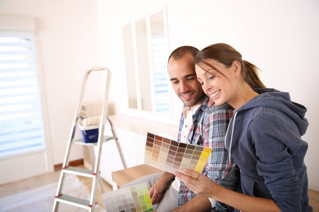 Couple choosing color for the walls