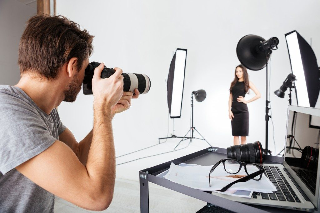 photographer and model in a studio