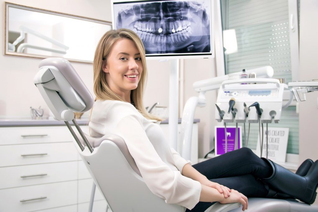 Woman sitting on dentist chair