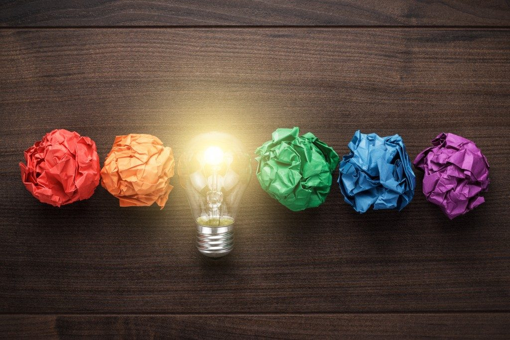 lightbulb with crumpled colored paper