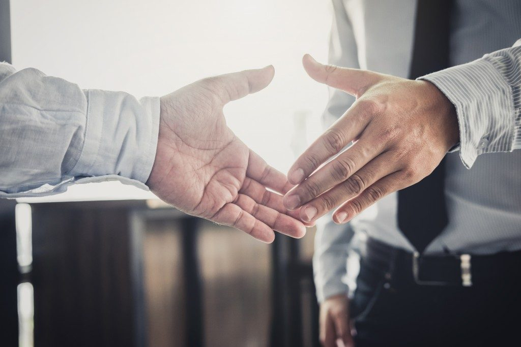 Two businessmen goint ot shake hands