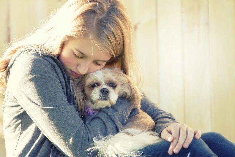 Owner hugging her pet