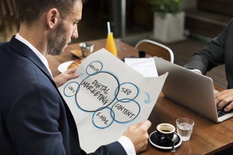 Employee holding marketing plan