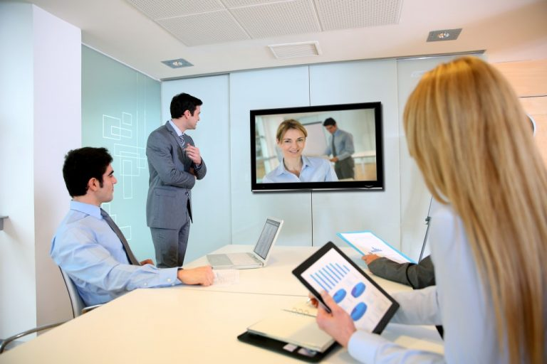 Business people watching a company video
