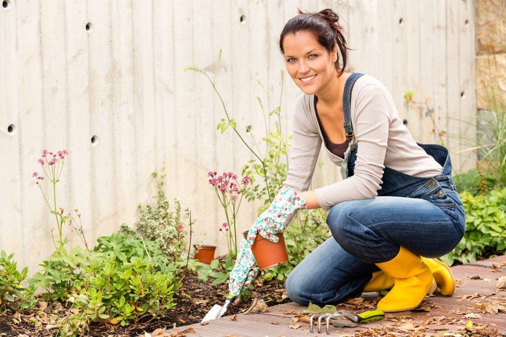 Woman gardening in her lawn