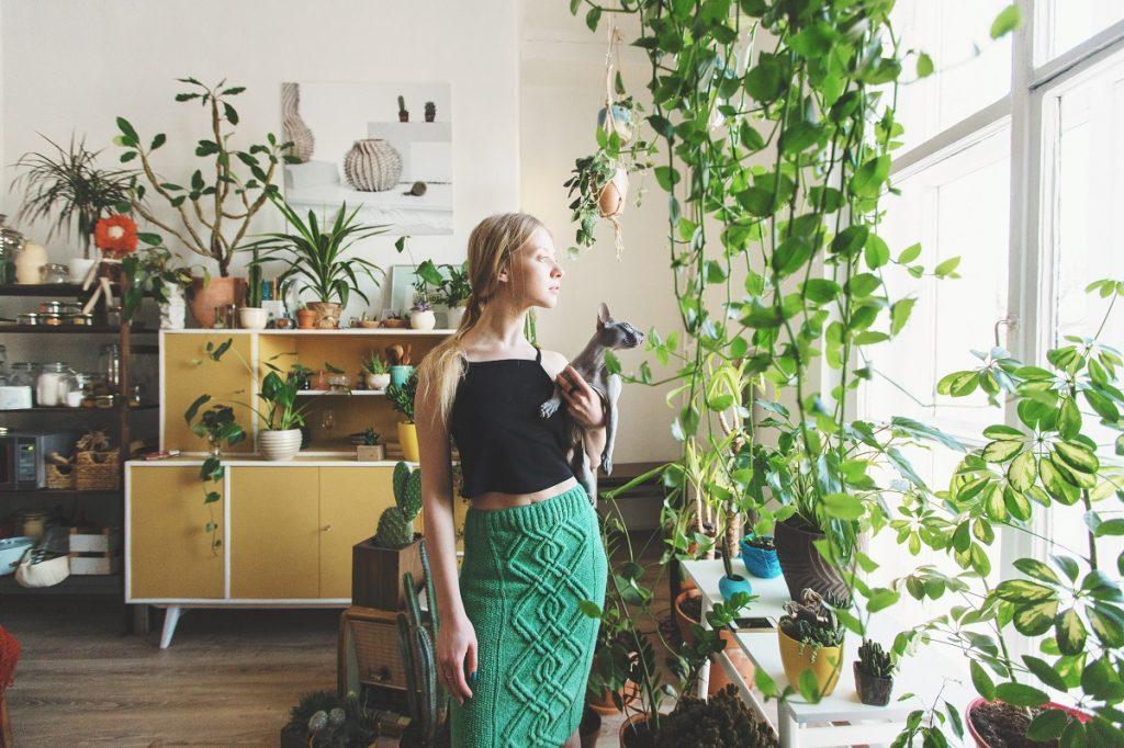woman with a house full of plants