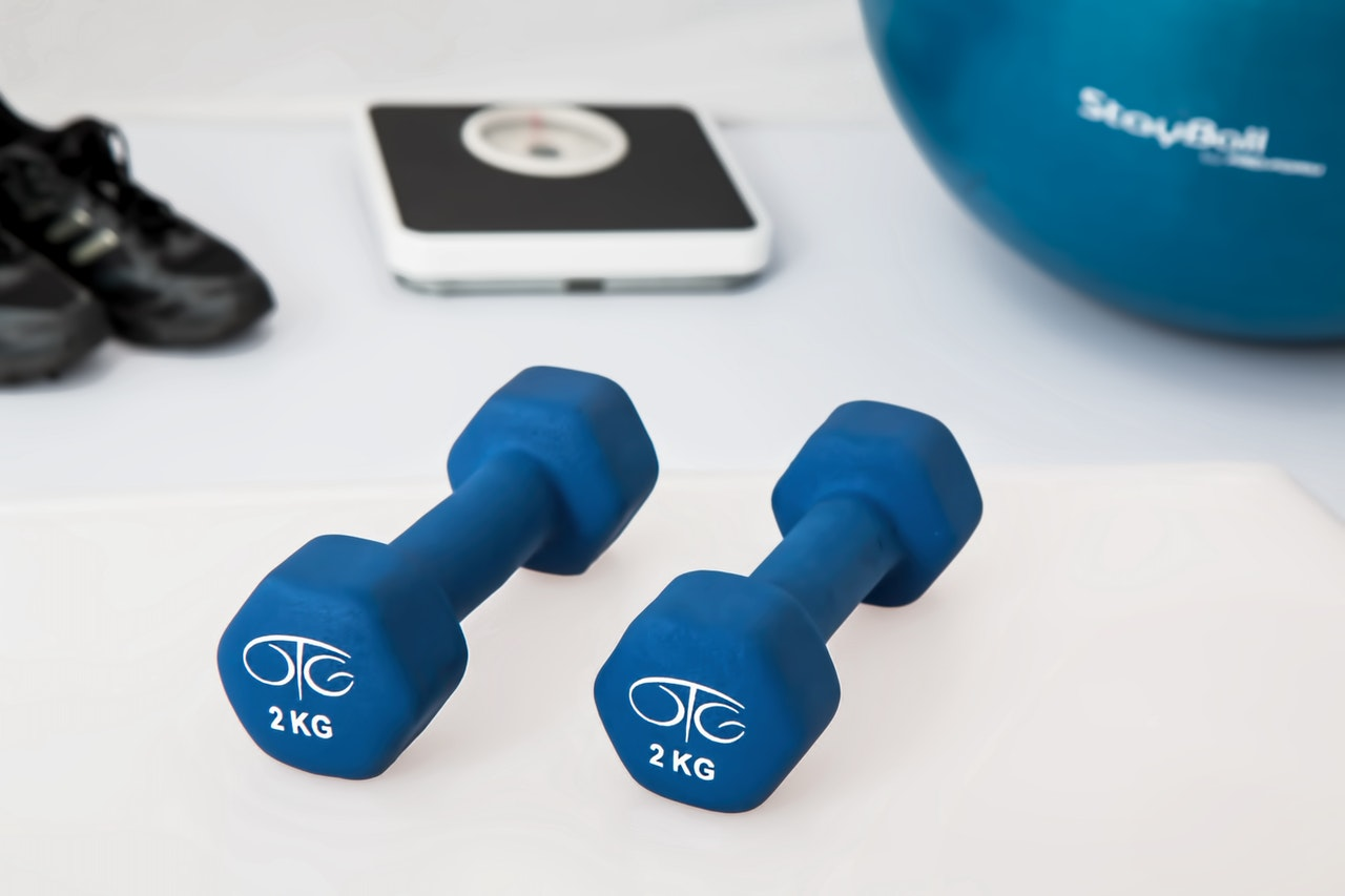 dumbbells with company logo