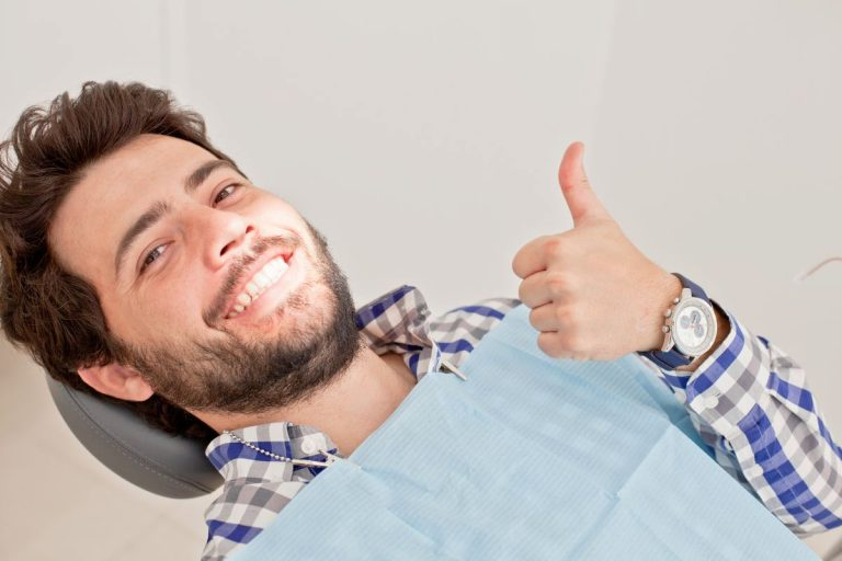 man smiling while at the dentists
