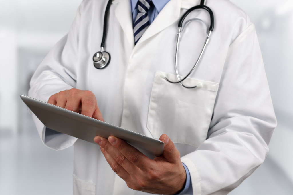 doctor with a stethoscope and clipboard